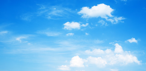 Sunny background, blue sky with white clouds
