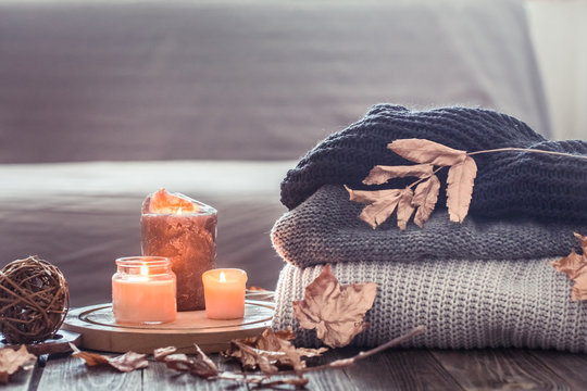 Cozy autumn still life with candles and a sweater
