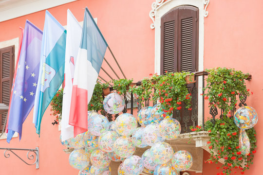 Novigrad, Istria, Croatia - Flags and beachballs at a picturesque balcony