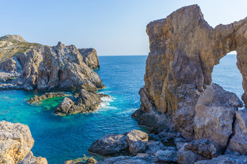 Kamarela a wild rocky beach with beautiful rocks complex and turquoise sea waters in Antikythera island in Greece Fotobehang