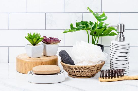 Herb soap, shower sponge inside a bright bathroom background.
