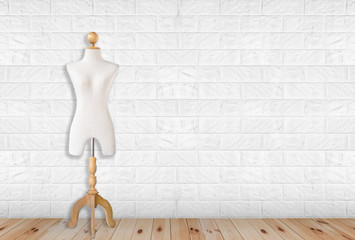 Vintage mannequin on white modern brick wall.