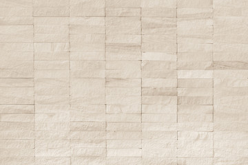 Rock stone tile wall texture rough patterned background in white cream color
