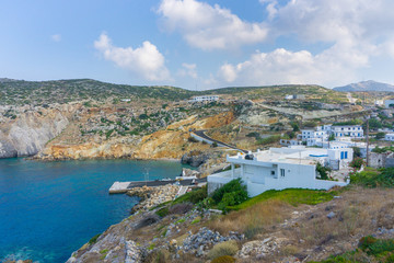 Potamos village with the port and the traditional white houses with blue windows in Antikythera island in Greece