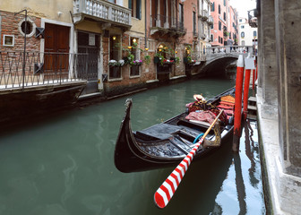 Canal with gondola in Venice.