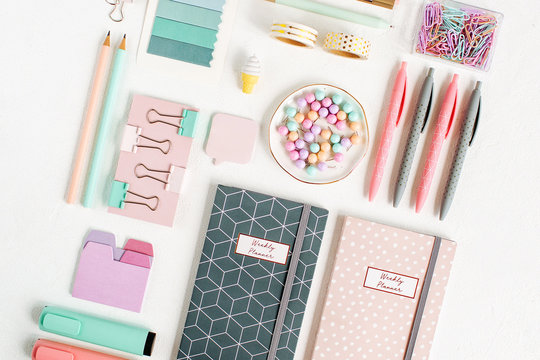 School supplies. Stylish stationery in pink and blue pastel color. Flat lay, top view.