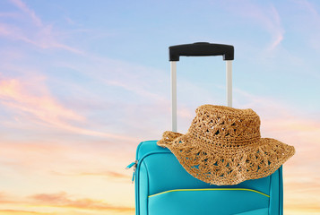 Fototapete - holidays. travel concept. blue suitcase infront of tropical background