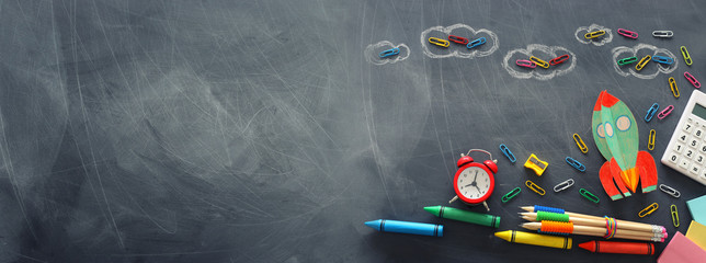 education. Back to school concept. rocket cut from paper and painted over blackboard background....