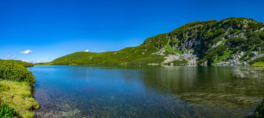 Fototapete - The lower lake, one of the seven rila lakes in Bulgaria