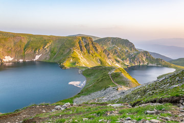 Fototapete - Sunrise view of the eye and kidney lakes, one of the seven rila lakes in Bulgaria