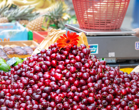 pile of cherries on the market