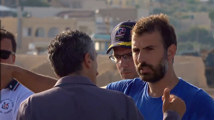 "A still image from a video footage shows a member of the crew of migrant rescue boat ""Alex"" talking with authorities after the vessel docked at the port of Lampedusa in defiance of a ban on entering Italian waters, in Lampedusa"