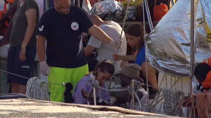 "A still image from a video footage shows a doctor attending a migrant on board of a migrant rescue boat ""Alex"", after the vessel docked at the port of Lampedusa in defiance of a ban on entering Italian waters, in Lampedusa"