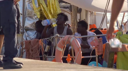 "A still image from a video footage shows migrants sitting on board of a migrant rescue boat ""Alex"", after the vessel docked at the port of Lampedusa in defiance of a ban on entering Italian waters, in Lampedusa"