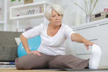 senior woman exercising in home gym