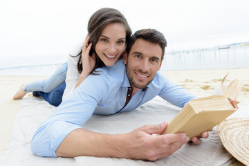 happy lovers reading a book together