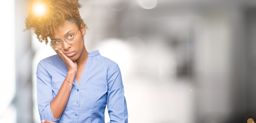 Beautiful young african american business woman over isolated background thinking looking tired and...