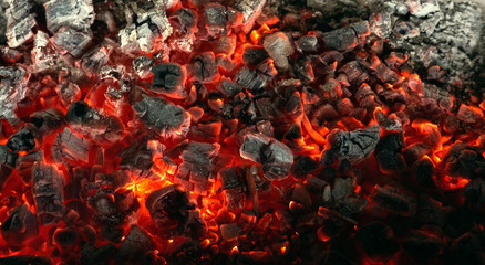 Poster Firewood texture Burning coals from a fire abstract background.