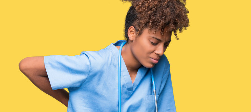 Young african american doctor woman over isolated background Suffering of backache, touching back with hand, muscular pain
