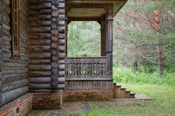 Porch of an old wooden house in the summer