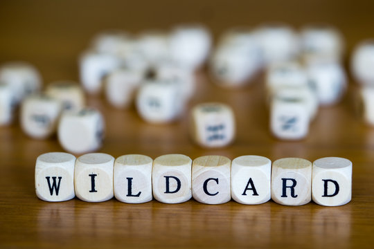 Wildcard written with wooden cube