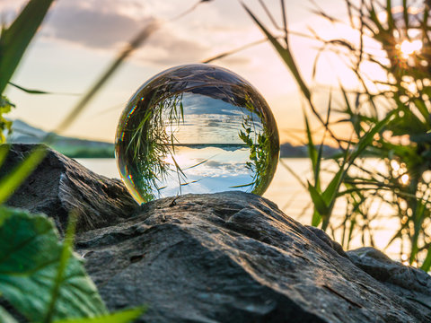 Sunset on the lake with a glass ball