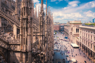 View of people enjoying Piazza del Duomo with the ornate architecture of the  Milan Cathedral Lombardy, Italy