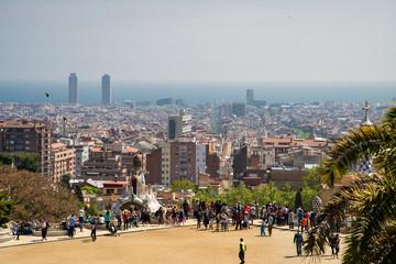 Foto auf Acrylglas Barcelona Barcelona, Spain - April, 2019: Park Guell Colorful Wide View of Buildings with Tourists with tourist view on Barcelona