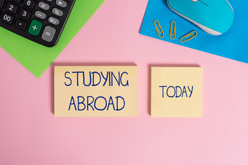 Writing note showing Studying Abroad. Business concept for learn outside of home in foreign country...