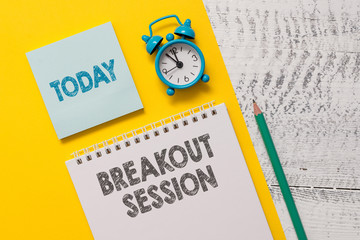 Text sign showing Breakout Session. Business photo showcasing workshop discussion or presentation on specific topic Spiral notepad paper sheet marker alarm clock retro wooden background