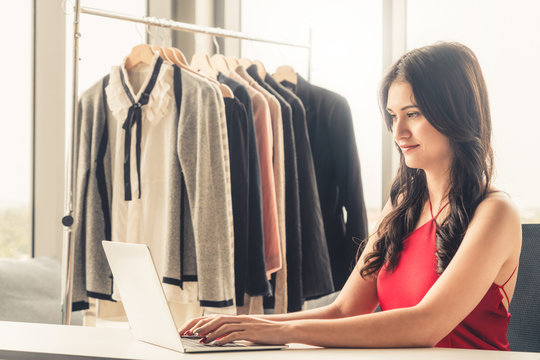 Online seller business woman working at office. Young entrepreneur taking online orders.