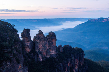 Three sisters rock during sunrise in Blue Mountains National Park (Sydney, New South Wales, Australia)