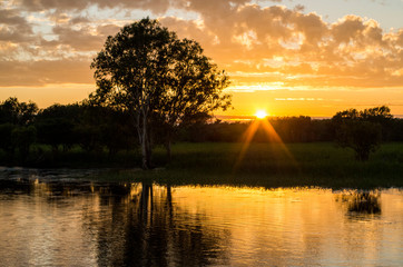 Beautiful orange (cloudy) sunrice in the Kakadu Nation Park, Australia (Yellow Water River, Billabong, Wetland)