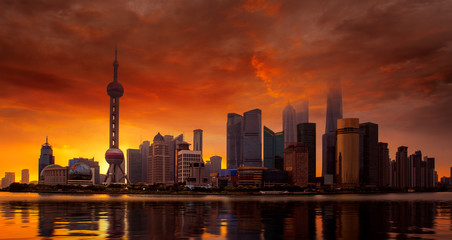Wall Mural - Shanghai skyline and sunset on the Huangpu River at sunset,China