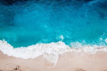 Wild beach, top view, waves