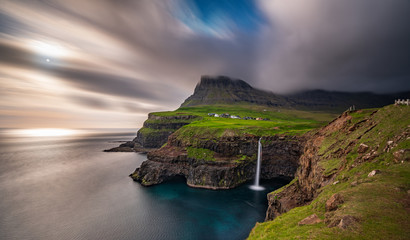 Gasadalur waterfall wide long exposure in Faroe Islands, misty day Fototapete