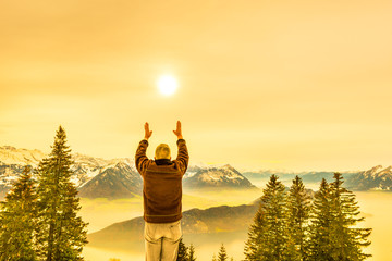 The man is happy with nature and life. Reach the sun.