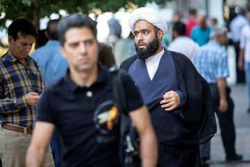 People walk in Tehran