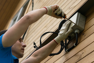 electrician connects house to electricity, close-up