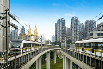 Fotomurales - the light rail train shuttles through the city.