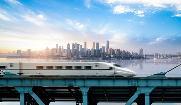 High-speed rail speeds on Bridges and the modern city skyline of chongqing, China