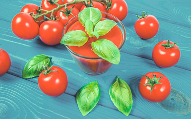 Fresh tomato juice as a source of vitamins. Wooden background.