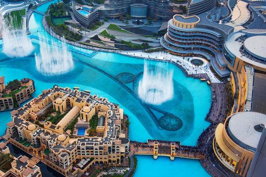 Dubai mall fountain and modern downtown buildings