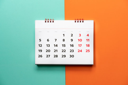 close up of calendar on the color table, planning for business meeting or travel planning concept