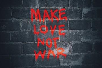 Make love not war graffiti on the wall