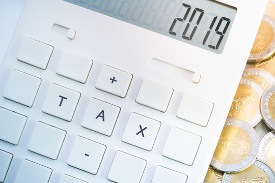 Tax 2019 on calculator for business and taxation concept.
