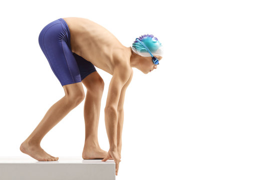 Young boy swimmer preparing for a swim