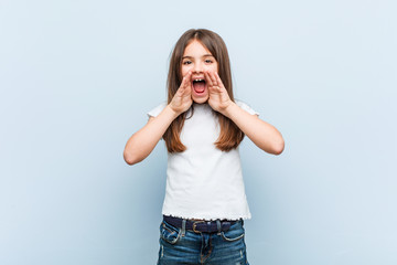Cute girl shouting excited to front. Wall mural