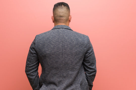 Young elegant latin man from behind, looking back