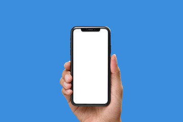 Hand holding the black smartphone with blank screen and modern frame less design on blue colour background